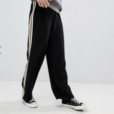 ASOS - Pantalon de jogging doux, large et cintré avec bordure contrastante